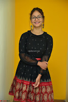 Aditi Myakal in Spicy Red Short Skirt and Transparent Black Top at at Big FM For Promotion of Movie Ami Tumi 072.JPG