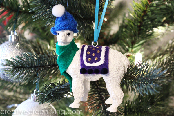 Baby llama with a hat Christmas ornament rom a toy