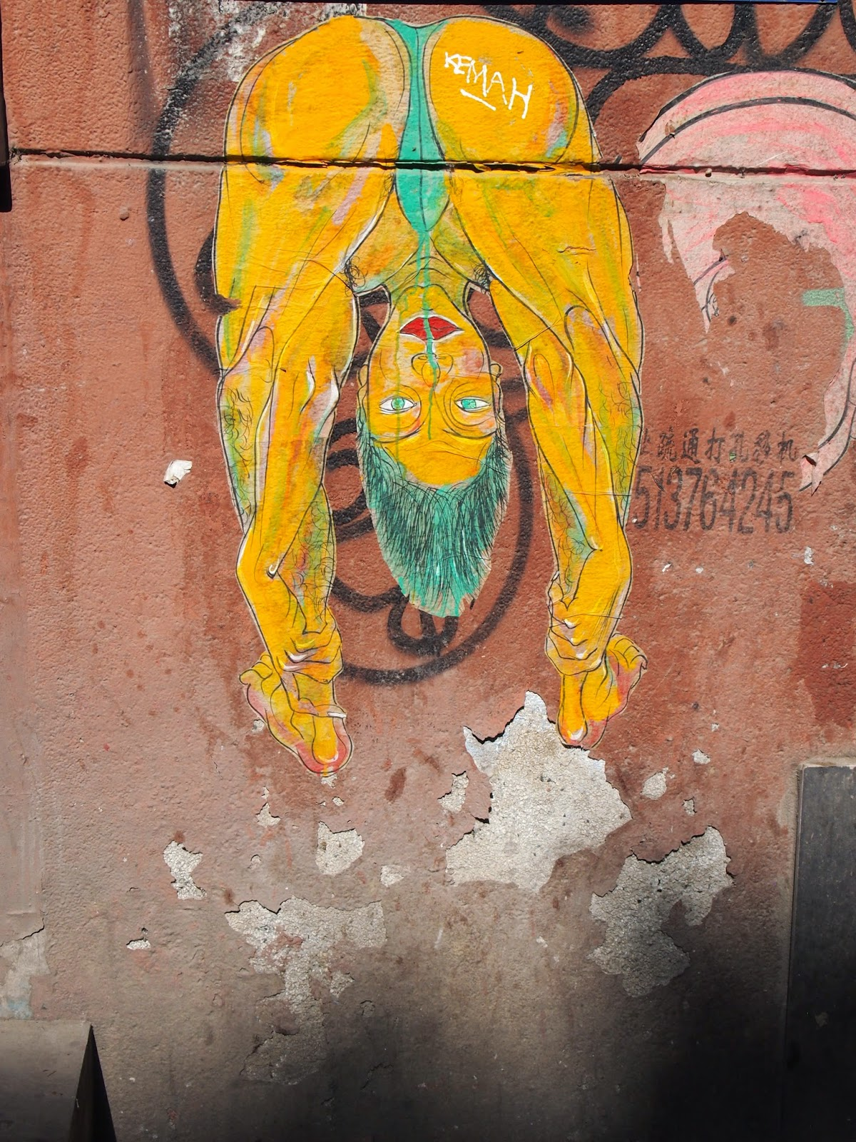 street art of a mostly nude yellow man