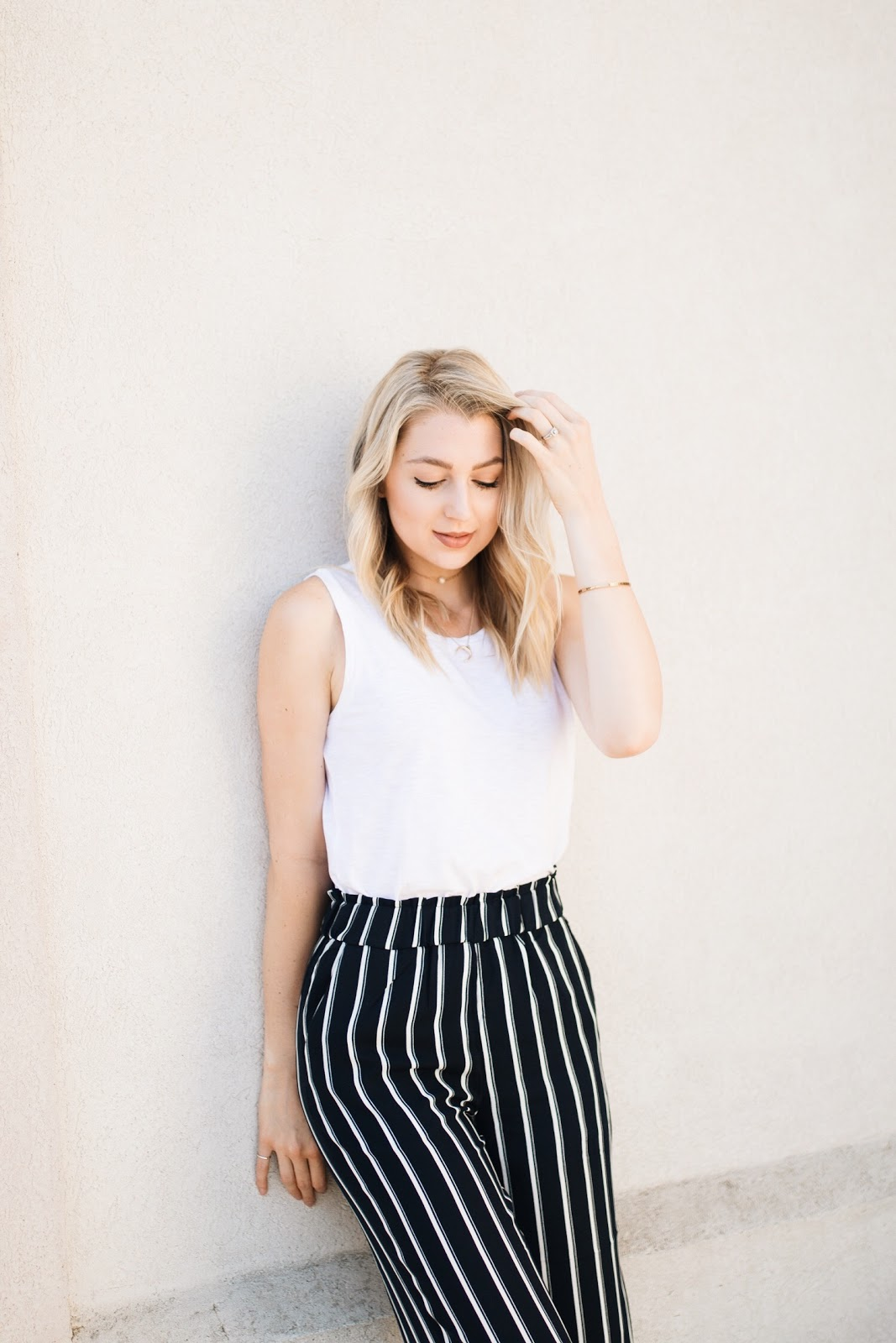 striped trousers with a simple white tank