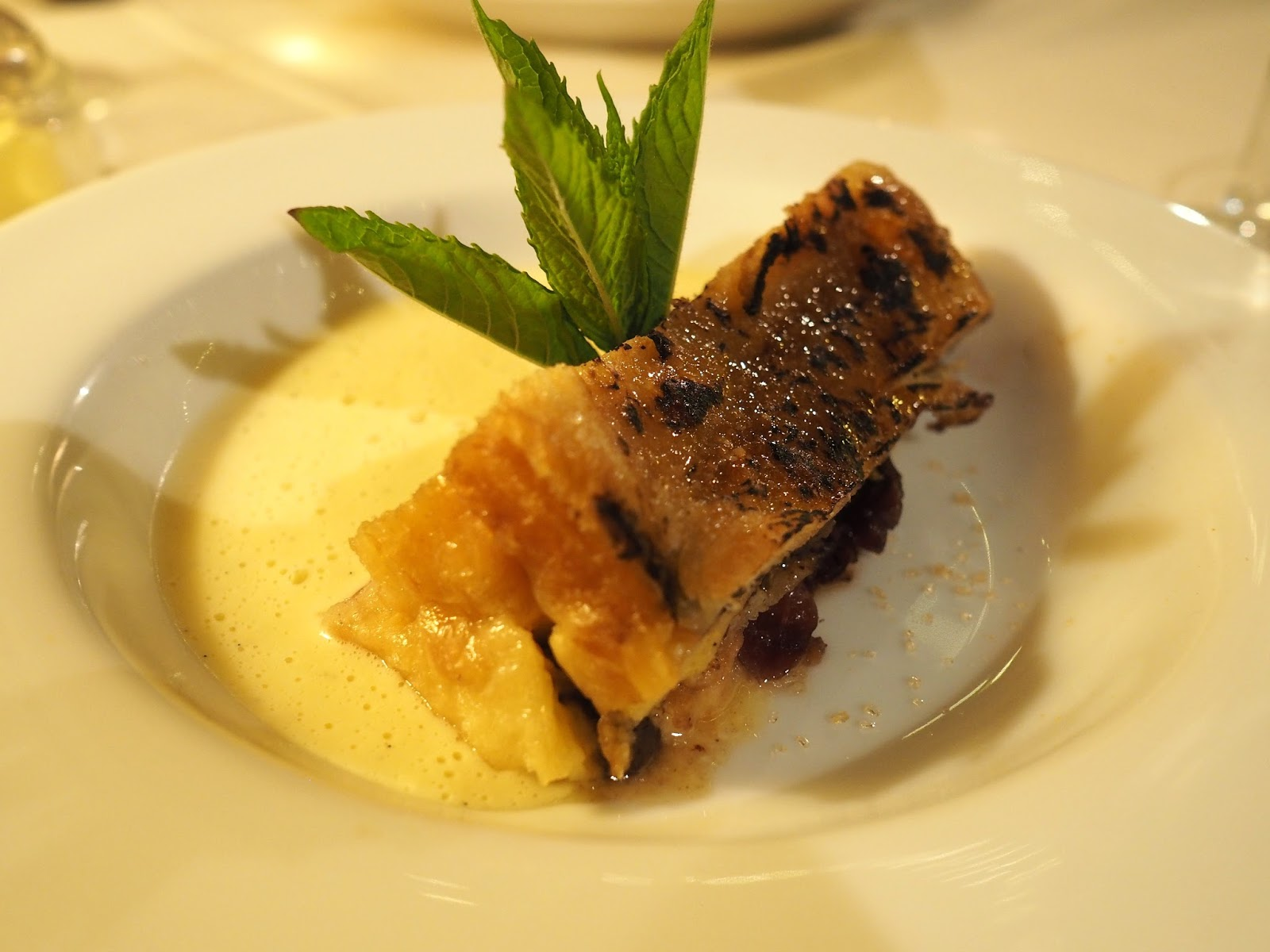 Chocolate bread and butter pudding with creme anglaise Le Caveau, excellent French restaurant in Skipton, North Yorkshire