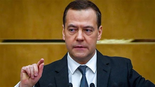 Russia's Prime Minister Dmitry Medvedev lends support for looming bill criminalizing adherence to US sanctions