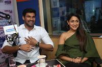 Pragya Jaiswal in a single Sleeves Off Shoulder Green Top Black Leggings promoting JJN Movie at Radio City 10.08.2017 025.JPG