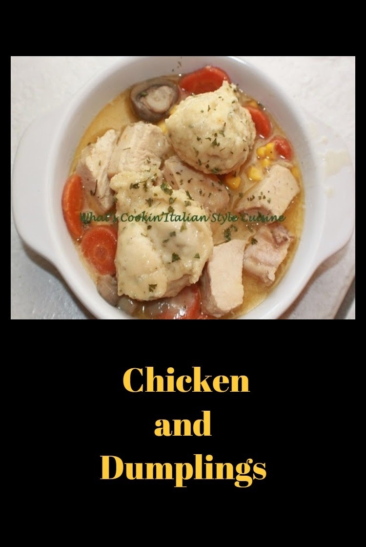 chicken and dumplings with vegetables in a white plate swimming in a delicious broth dumpling sauce with herbs and spices, corn, carrots, loaded chicken and puffed up dumplings on top