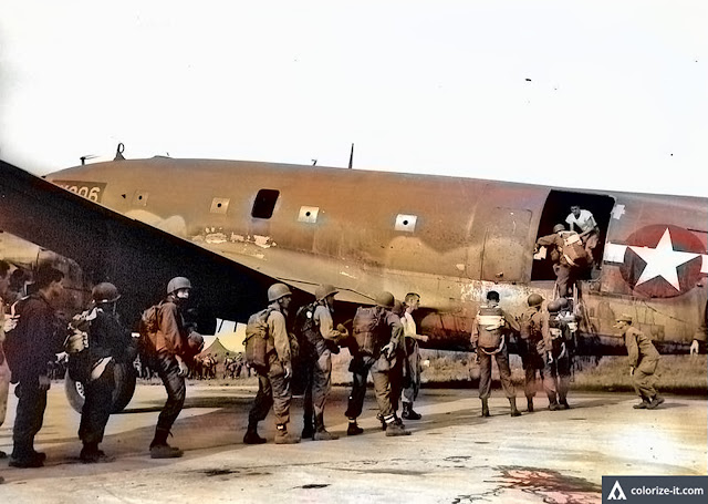 Troops of the 11th Airborne are seen boarding a transport plane.  Image source:  United States National Archives.  Colorized courtesy of Algorithmia.
