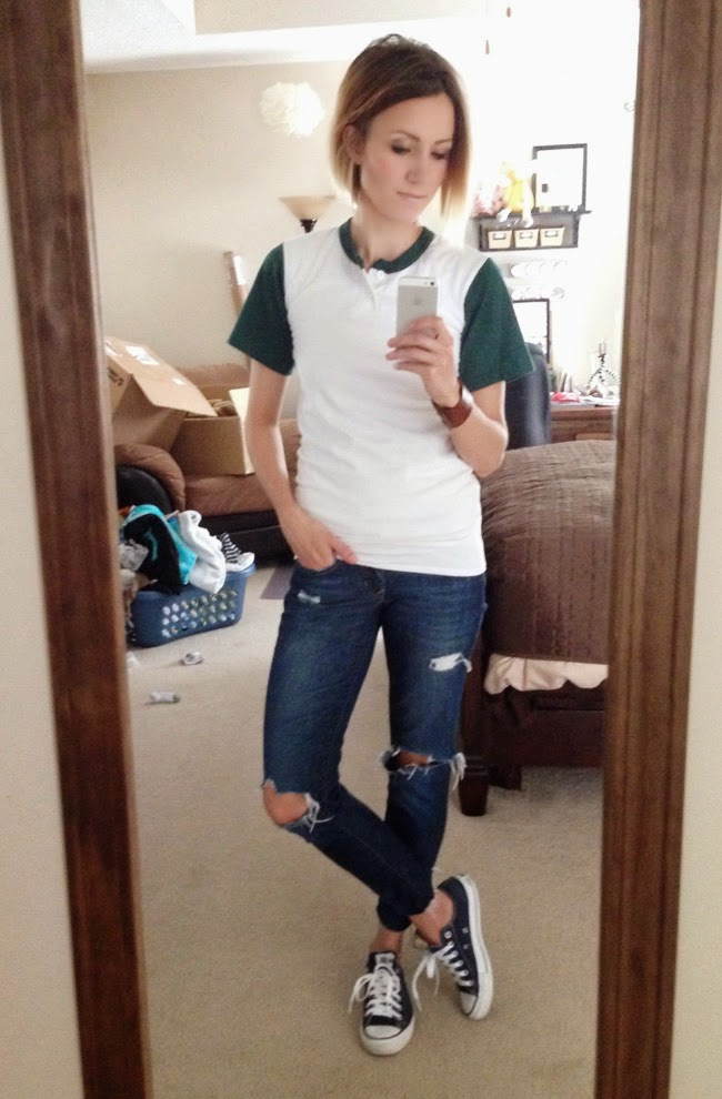 Sporty baseball tee, distressed denim and Converse