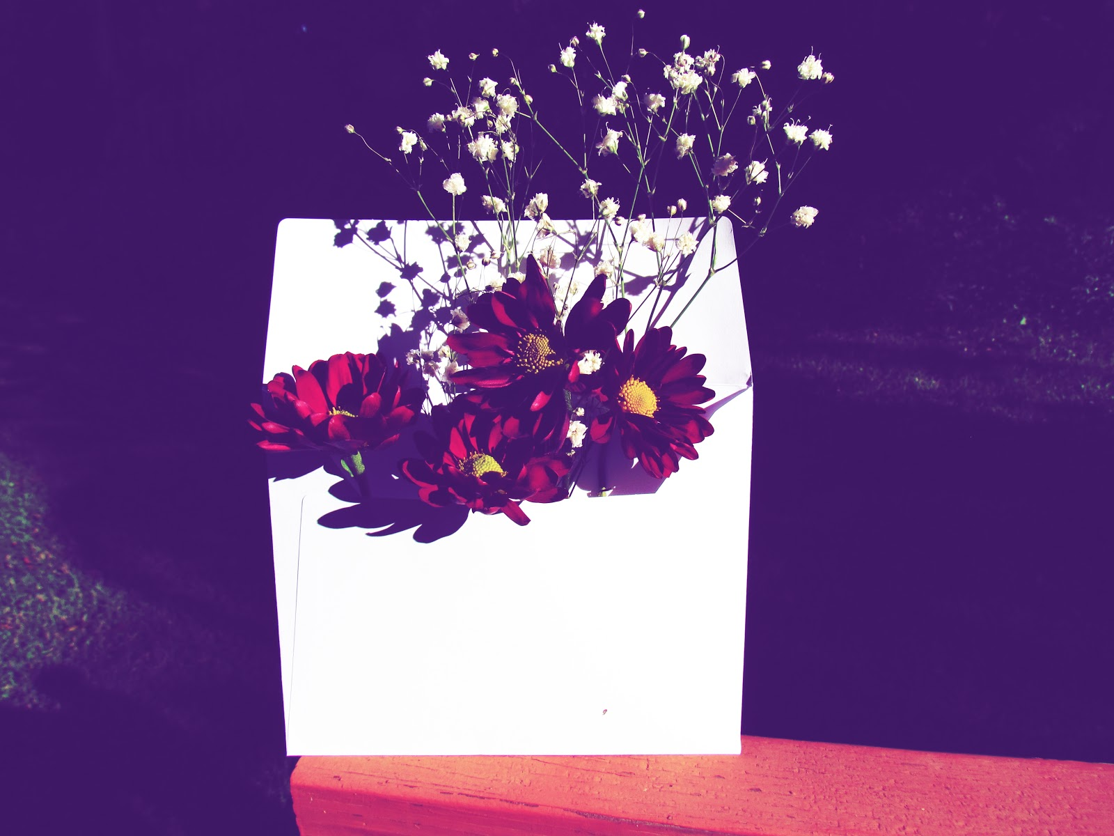 A White Envelope Floral Arrangement Carrying Autumn Inspired Nature Art Display