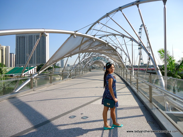 Lady walking in the Helix Bridge Singapore