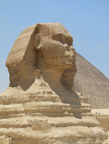 Classic side view of The Great Sphinx, Giza (Khufu Pyramid behind)