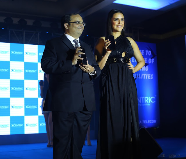 Priyanka Communications MD, Manish Agarwal with Bollywood actor Neha Dhupia at the CENTRiC Smartphone launch