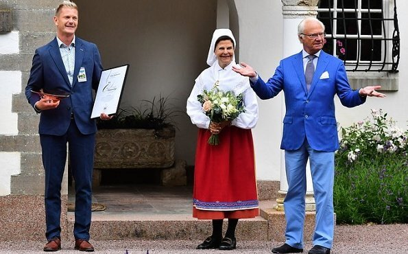Solliden Palace in Öland. Queen Silvia is wearing a traditional local costume of Oland