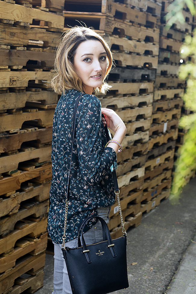 Dark Floral Blouse and Grey Skinny Jeans with Kate Spade Bag