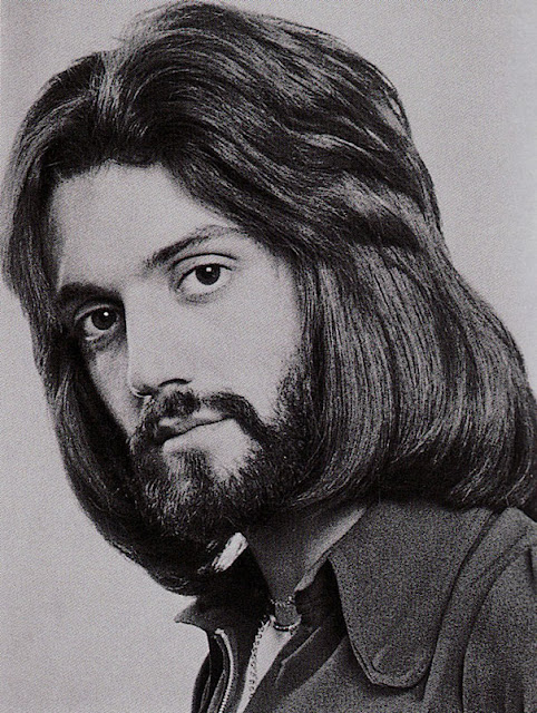 Men hairstyle 1970s. Big, fluffy, feathered bangs and a beard. Looking good. As Seen on TV and other stories of marketing the American Dream. marchmatron.com