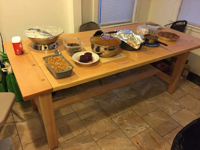 photo of table with platters of thanksgiving foods arrayed for serving
