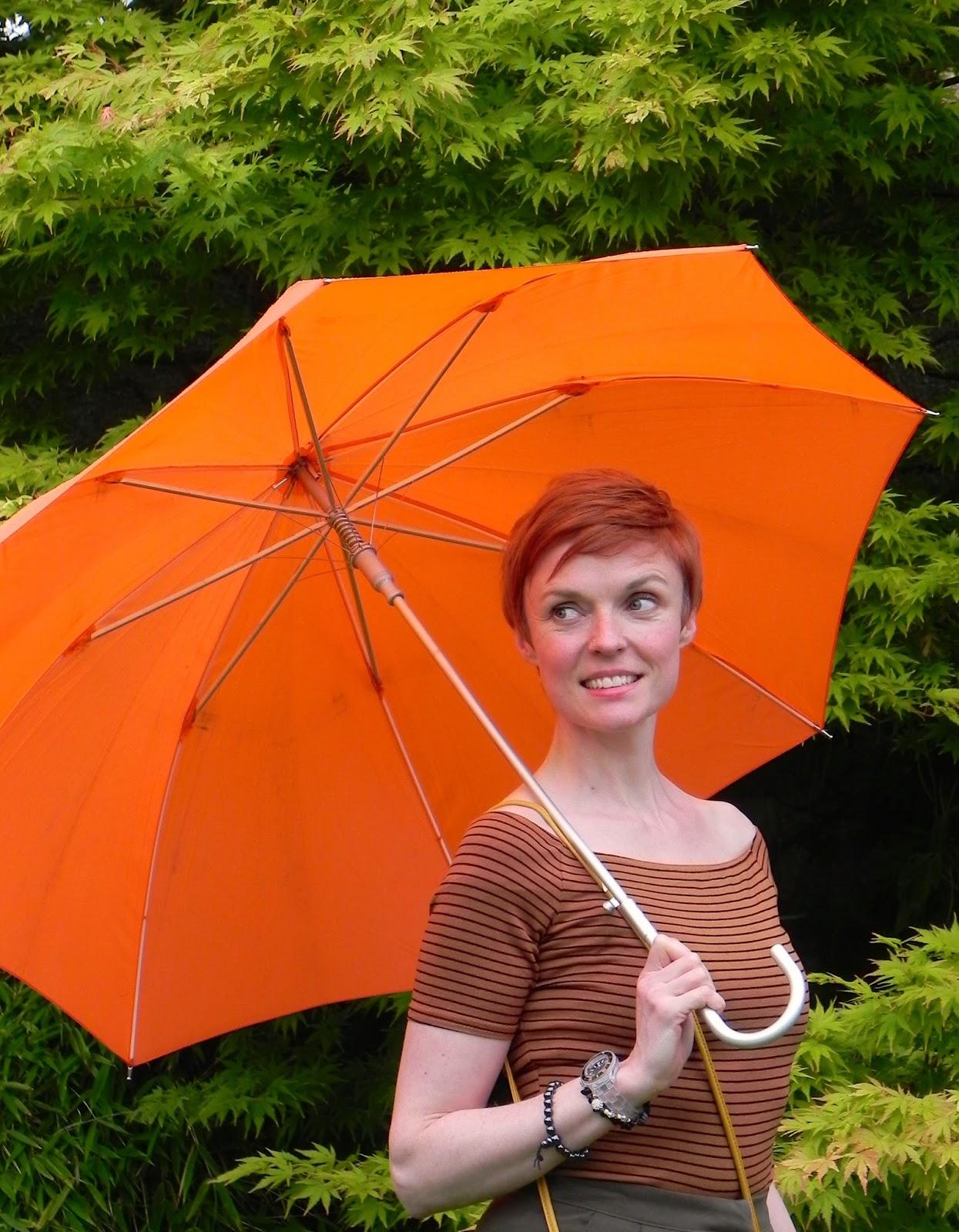 culottes, orange umbrella, bardot top