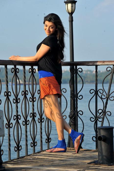 Kollywood Hot Actress Kajal Agarwal Legs Thighs Stills In Mini Black Dress