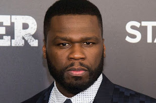 50cent reacts as his estranged son poses with Mcgriff's son