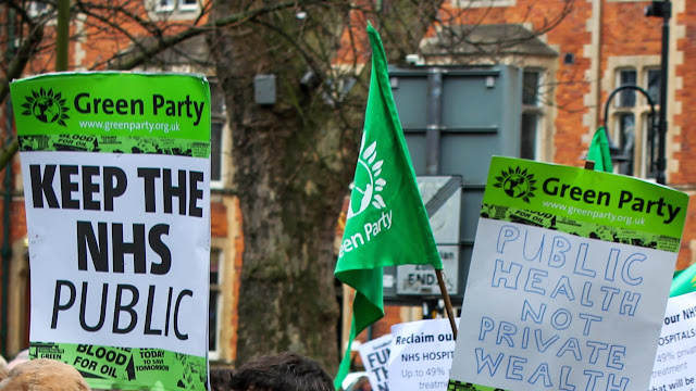 Green Party banner that reads keep the NHS public