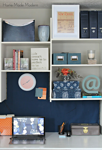 cork board wall with fabric and nailhead trim
