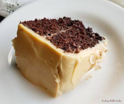 slice of devilishly good chocolate cake with caramel frosting