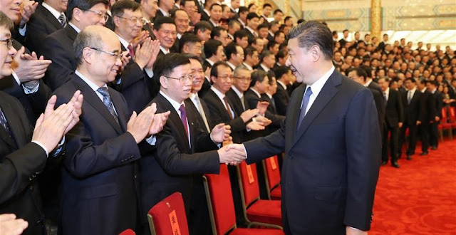 Chinese President Xi Jinping (R, front), also general secretary of the Communist Party of China Central Committee and chairman of the Central Military Commission, meets representatives of space scientists and engineers who participated in the research and development of the Chang'e-4 mission at the Great Hall of the People in Beijing, capital of China, Feb. 20, 2019. Other senior leaders including Li Keqiang, Li Zhanshu, Wang Yang, Wang Huning, Zhao Leji and Han Zheng also attended the meeting. (Xinhua/Ju Peng)