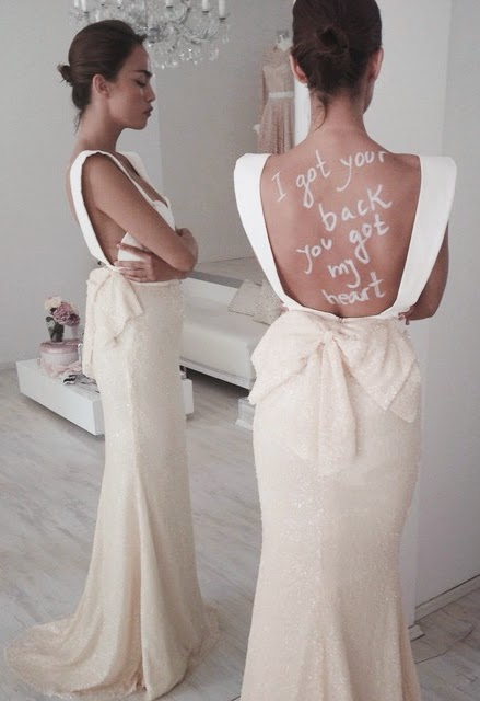Wearing a Backless Wedding Dress with Bow by Mihano Momosa