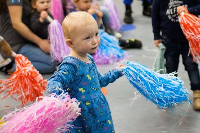 Children dancing with pom poms