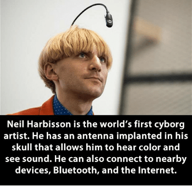 NEIL HARBISSON IS THE WORLD'S FIRST CYBORG ARTIST HE HAS AN ANTENNA IMPLANTED IN HIS SKULL THAT ALLOWS HIM TO HEAR COLOR AND SEE SOUND HE CAN ALSO CONNECT TO NEARBY DEVICES BLUETOOTH AND THE INTERNET MEME