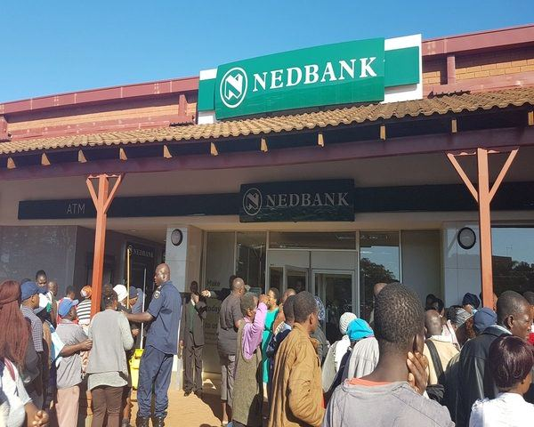 VBS clients queue at Nedbank ATM'S to get their cash