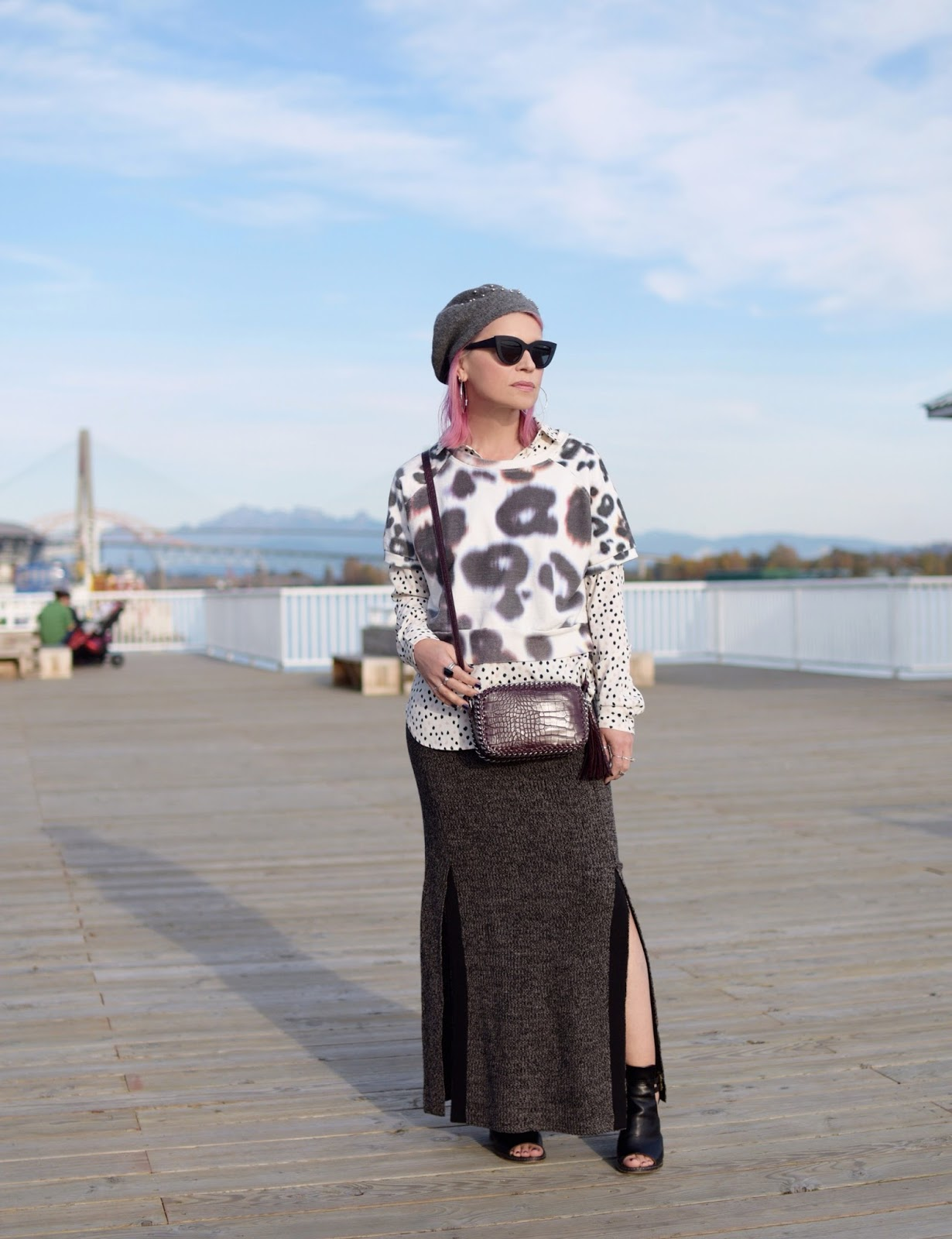 Monika Faulkner outfit inspiration - polka-dot blouse layered under a sweatshirt, knit maxi-skirt, and a beret