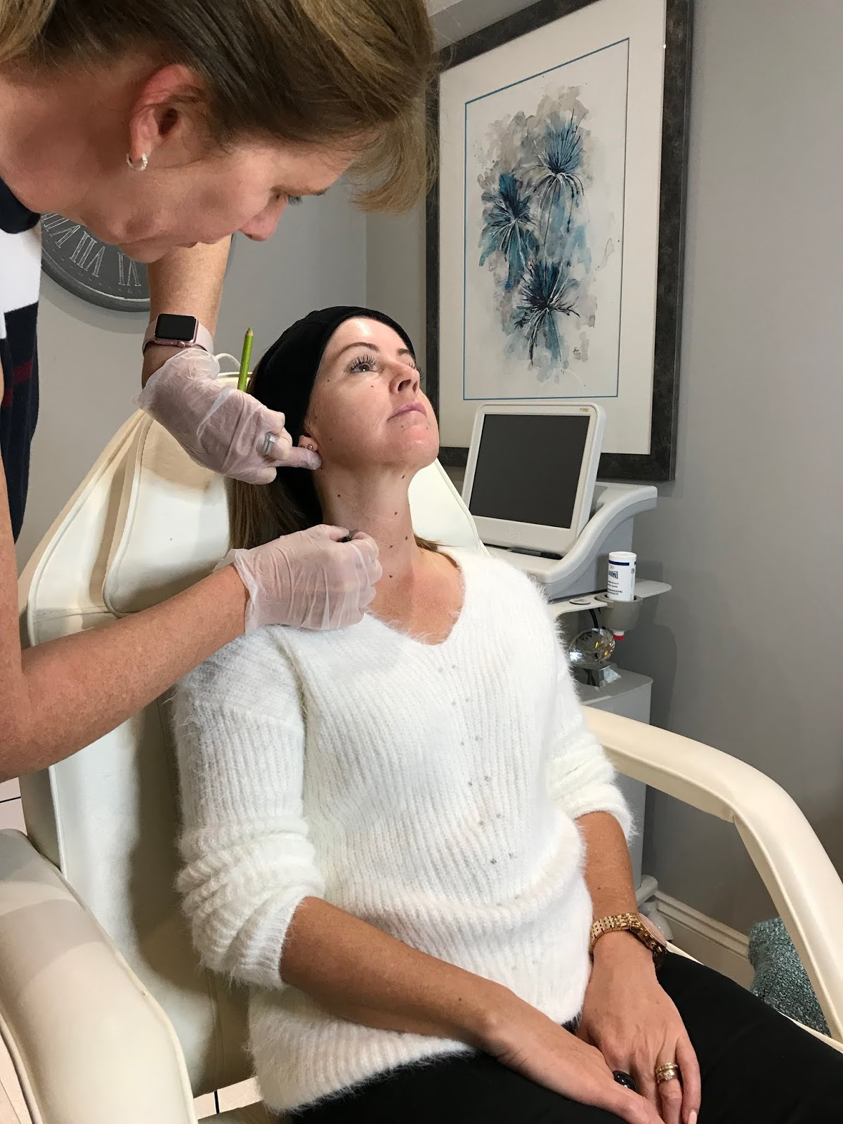 Dr Lorraine Hill marking up face and neck prior to Profhilo injections