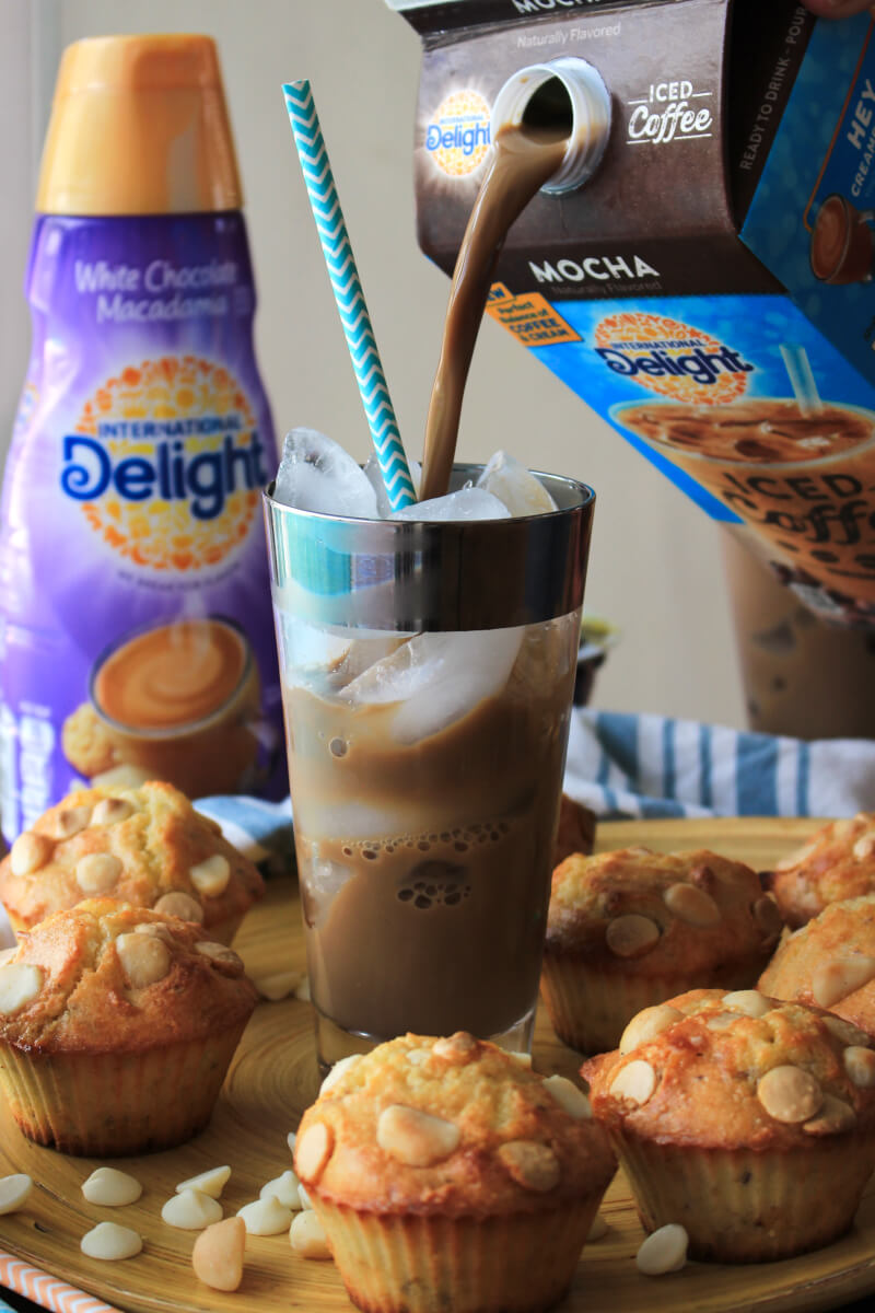 White Chocolate Macadamia Nut Muffins are the perfect grab and go breakfast or snack.  Pair with a glass of iced coffee and some Greek yogurt for a protein-packed treat that will boost your morning mood and re-energize your day! #perfectpickmeup #ad