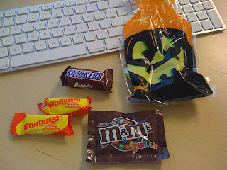 A Mini Candy Bar and Individual Bag of M&Ms