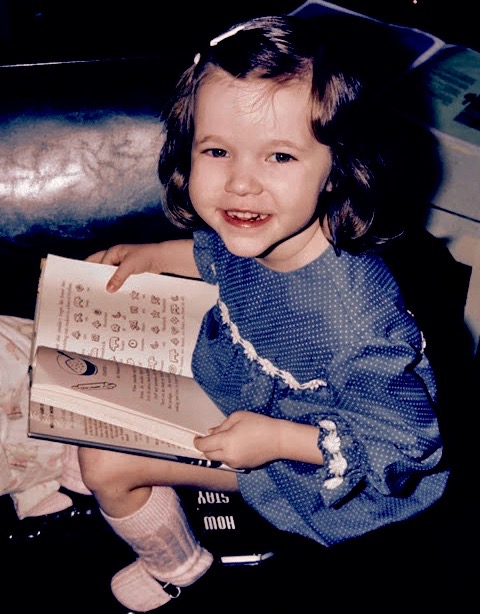 1975 first grade Reading in a blue dot dress.