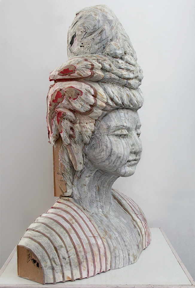 12-Avalokitesvara-Bodhisattva-Buddhas-Long-Bin-Chen-A-Second-Life-for-Recycled-Book-Sculpting-www-designstack-co
