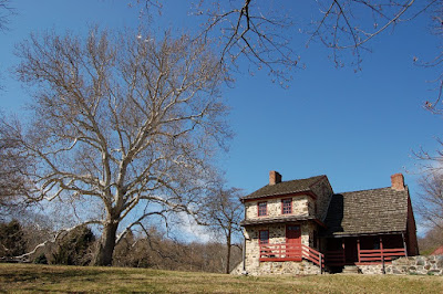 Gilpin House at Brandywine Battlefield with large sycamore tree to left