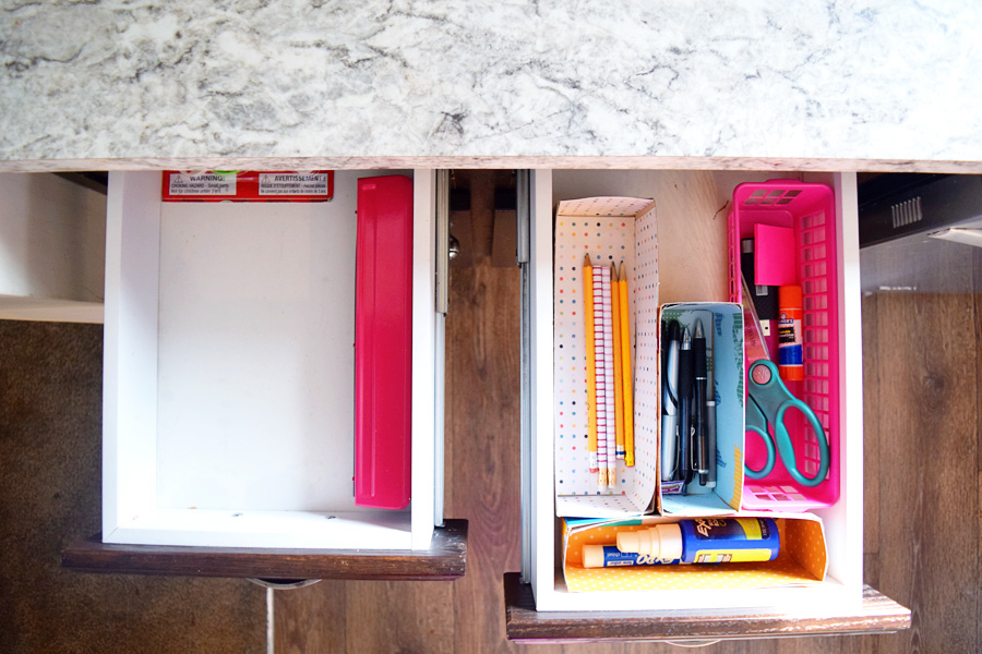organized homeschool supply cabinet