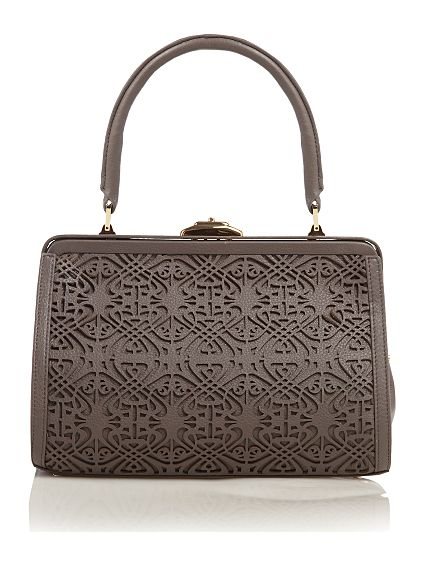 b7513c400ec7 One of my most interesting and coveted purchases from the high street was  from the Biba collection at House of Fraser. This intricate laser cut  leather bag ...