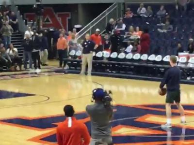 Auburn student Ben Bode makes half court shot
