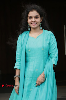 Tamil Actress Preethi Stills in Green Salwar Kameez at Kuzhalosai 2nd Anniversary Fund Raising Event  0024.jpg