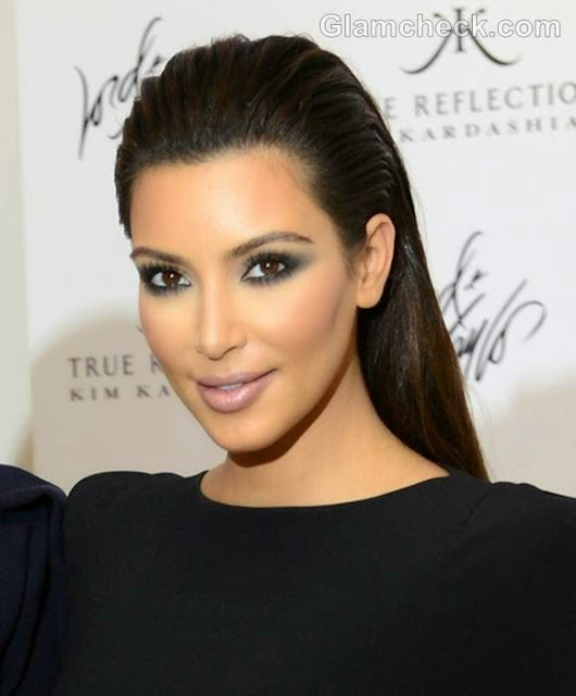 Kim Kardishian with the wet look featured on Addictions of a Fashion Junkie