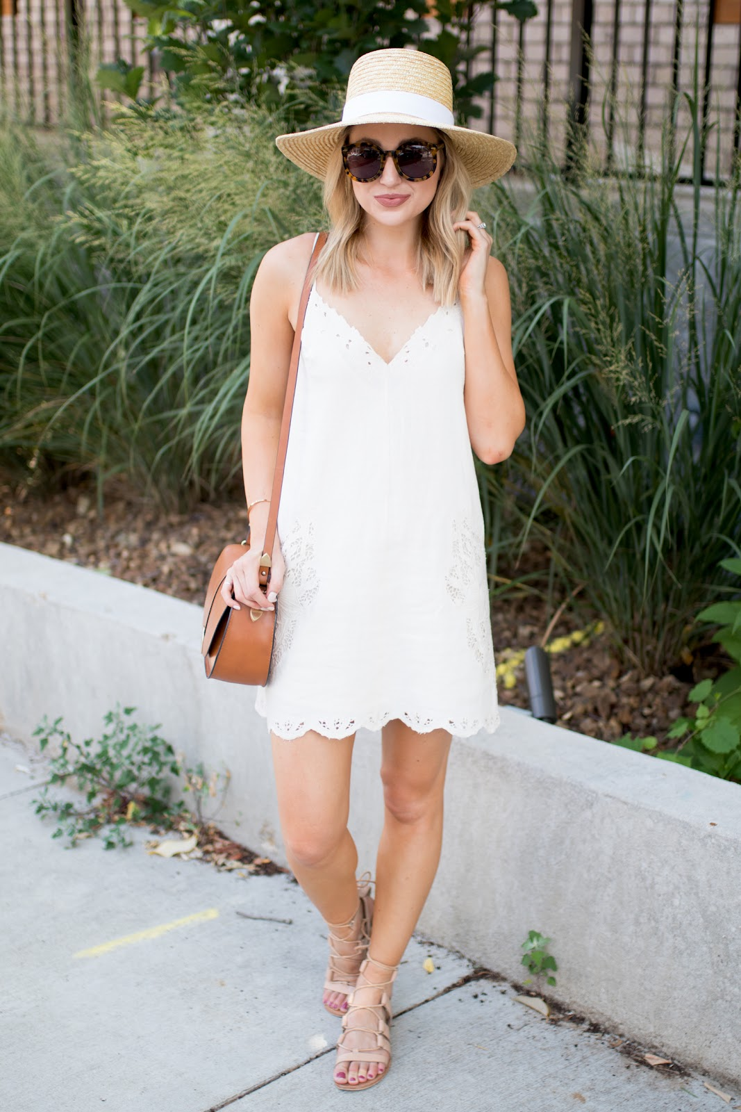 White eyelet sundress with a straw hat