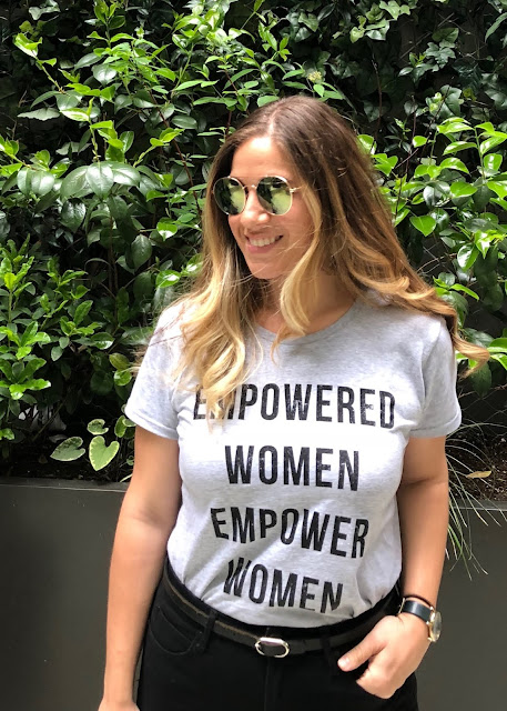 empowered women tee with high waisted black jeans