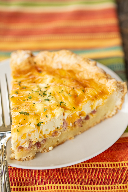 Ham and Cheese Biscuit Quiche - our FAVORITE quiche! The crust is made out of homemade biscuit dough. It is like a big open faced ham, egg and cheese biscuit. SO good!!! Self-Rising flour, butter, buttermilk, ham, cheese, eggs, half-and-half and sour cream. Great for breakfast, lunch or dinner. Everyone LOVES this yummy casserole!!! #quiche #breakfast #biscuit #ham