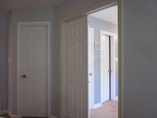 Townehouse interior painting - doors, railing and trim