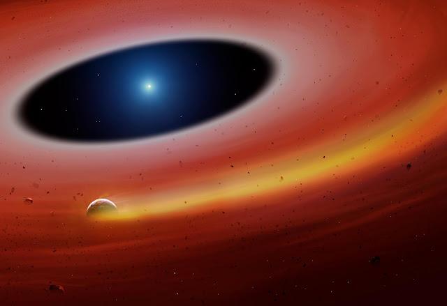 Rappresentazione artistica del frammento planetario mentre orbita attorno alla stella SDSS J122859.93+104032.9 lasciandosi una scia di gas alle spalle. Crediti: University of Warwick/Mark Garlick