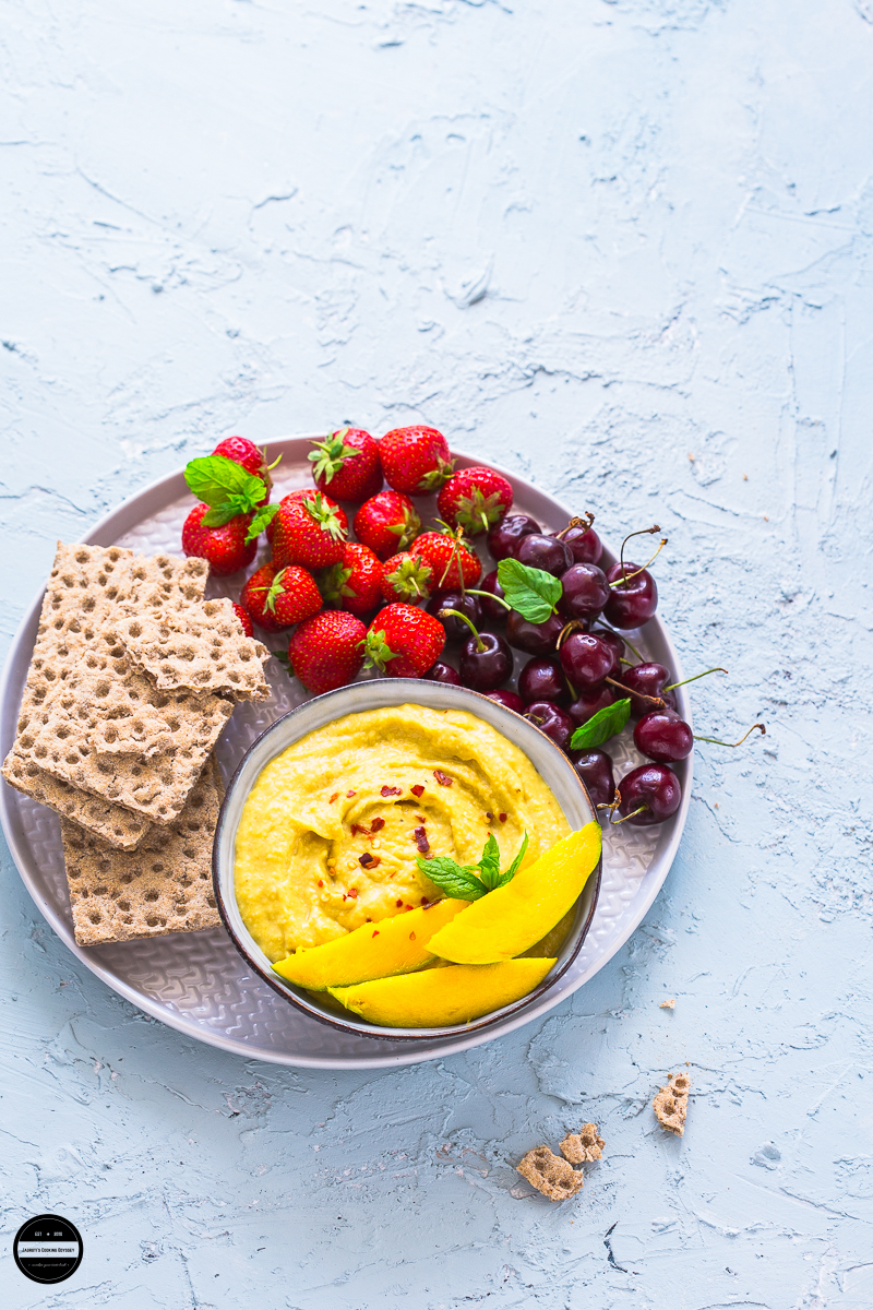 Mango and Chilli Hummus is a modern exotic twist to a traditional recipe of hummus. This delicious and vegan hummus dip is prepared with fresh mango and red chilli, and sure to please your taste buds if you like sweet but little spicy.