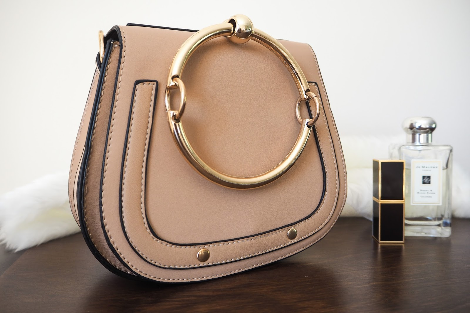 Beige handbag which is a dupe of the Chloe Nile