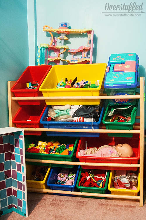 The process of organizing toys can be a painful one. Some ideas to cut down your toy population and get those toys organized!