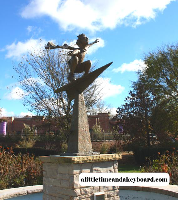 Flying boy sculpture in the Nancy Yahr Children's Garden at the Rotary Botanic Gardens in Janesville, Wisconsin.